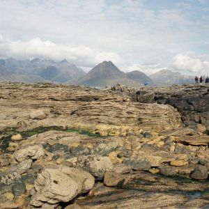 Jurassic tidal sandstones near Elgol, with the Cuillin Mountains behind, Isle of Skye